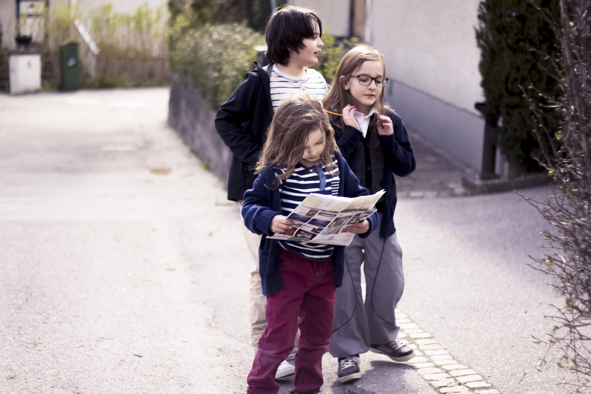 The kids following the map to find the ruin in Sigtuna