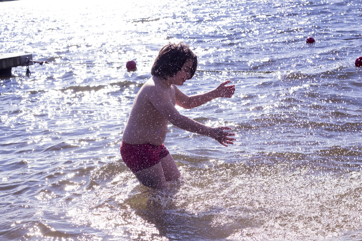 Jonathan splashing around in the water